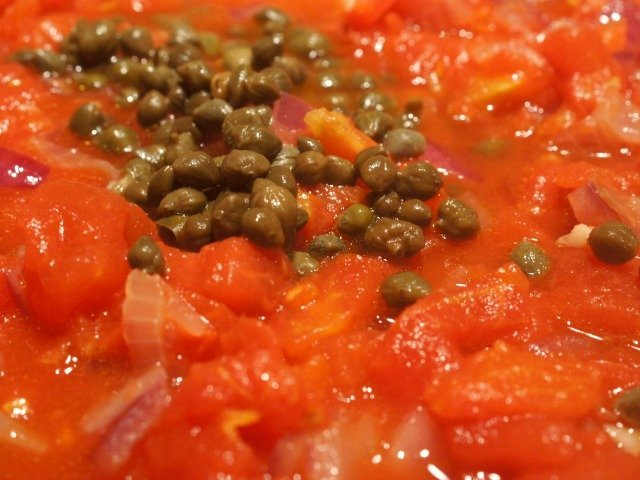 Add capers and tomatoes
