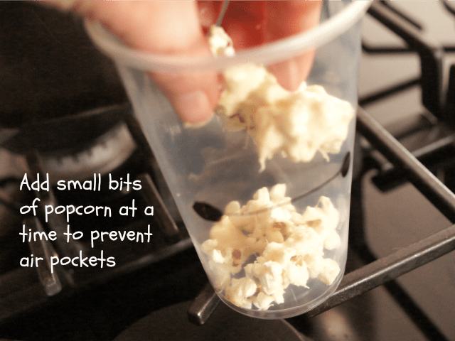 Adding marshmallow popcorn to Baymax cups