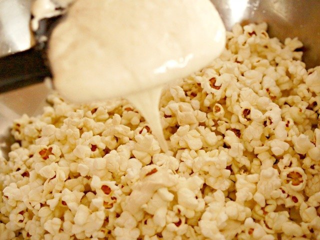 Drizzle marshmallow over popcorn