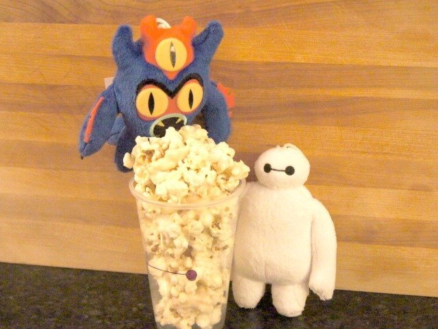 Fredzilla and Baymax posing with marshmallow pocorn