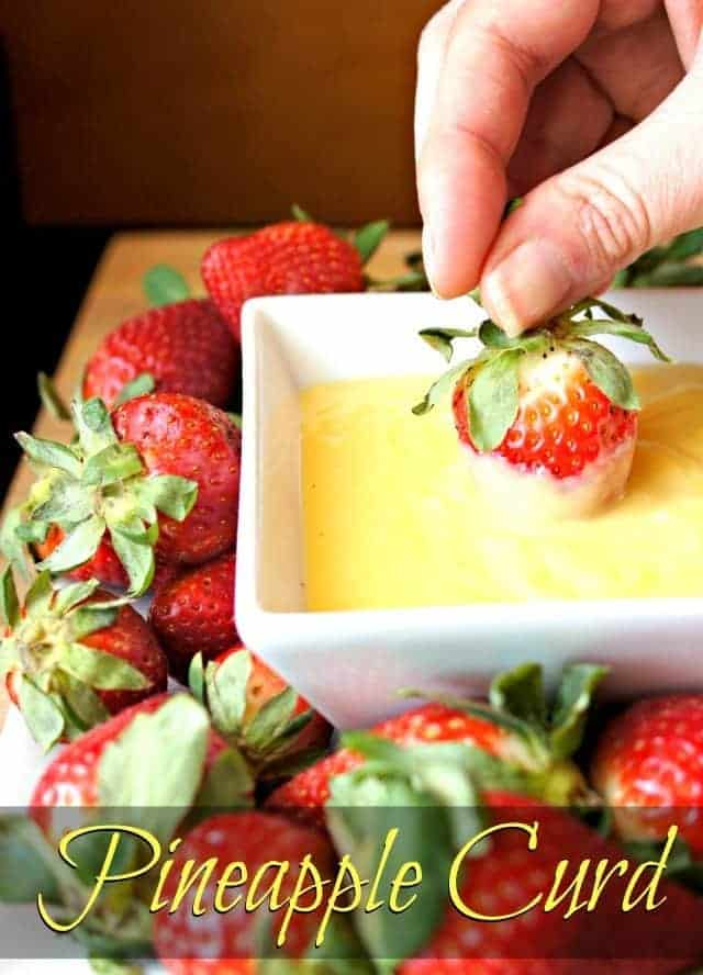 Dipping a strawberry in homemade pineapple curd