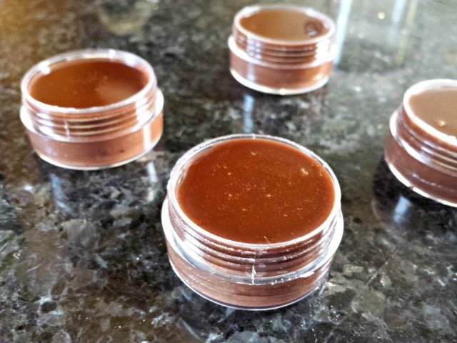 Homemade chocolate lip balm in containers