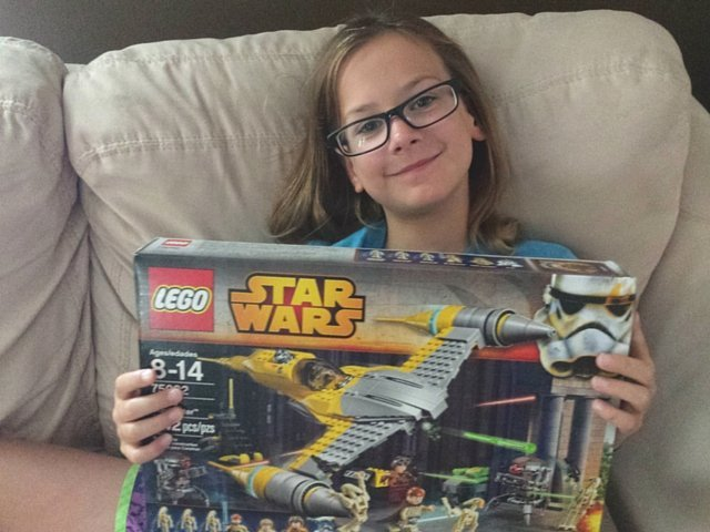 Thrilled with her new Star Wars Naboo Starfighter