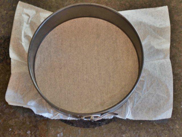 Line your springform pan with parchment paper