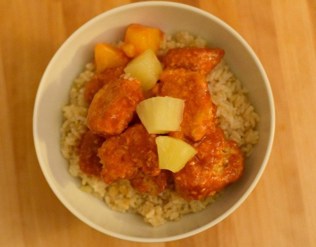 Delicious dinner of baked sweet and sour chicken