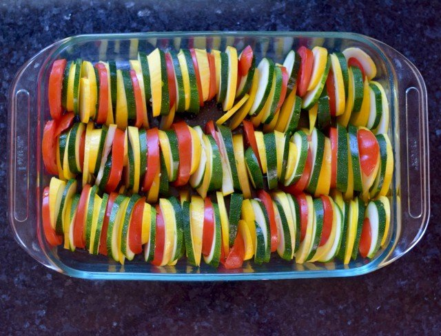 Layer veggies in baking dish for Italian Roasted Vegetables