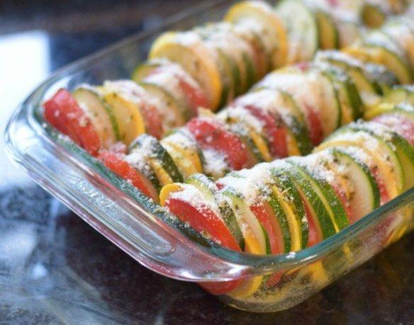 Sprinkle parmesan over sliced veggies
