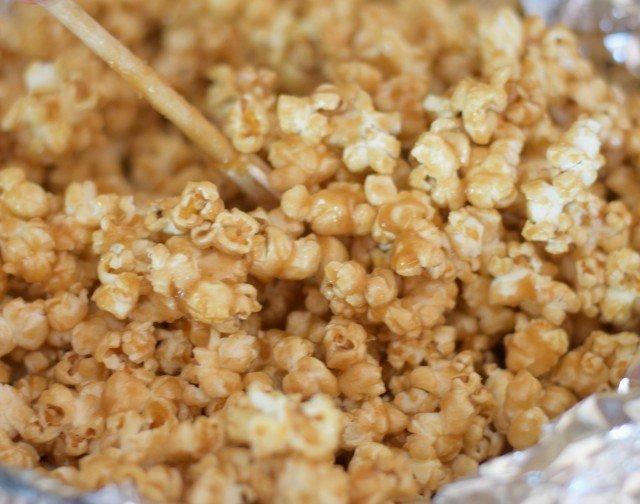 Stir the popcorn while baking