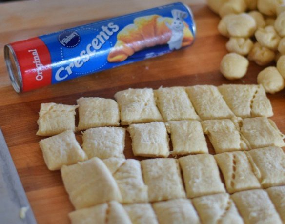 Cut crescent roll dough into squares then roll