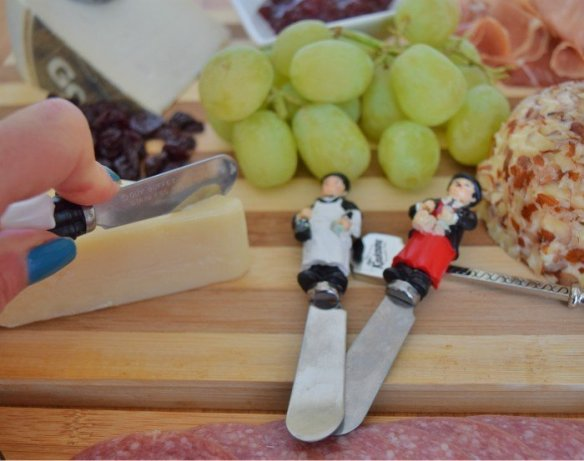 Cutting into a cheese platter