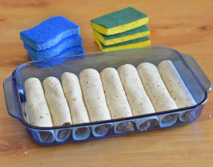 Add rolled tortillas to pan for easy chicken enchiladas