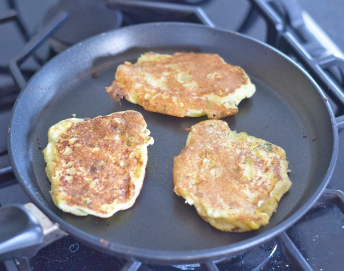 Flip corn fritters after golden on one side