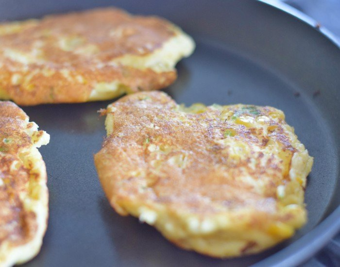Flip corn fritters after two minutes then cook the other side