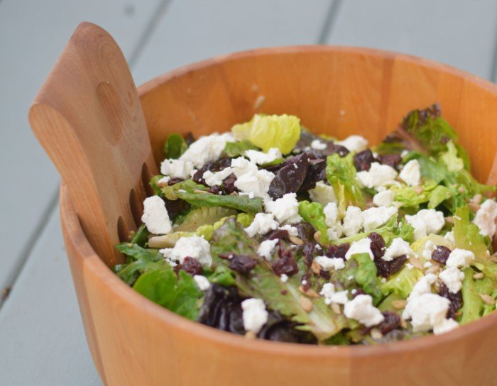 Simple summer salad for potluck with goat cheese and dried cherries