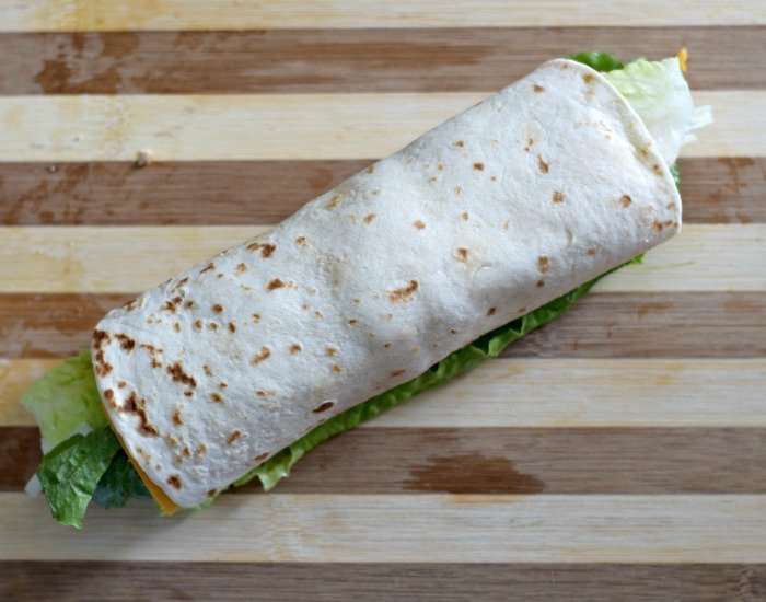 Roll chicken taco wraps tightly into a cylinder