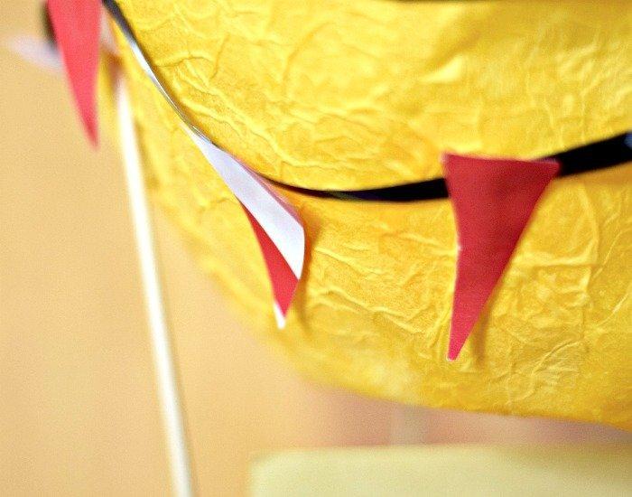 Add bunting to papier mache hot air balloon