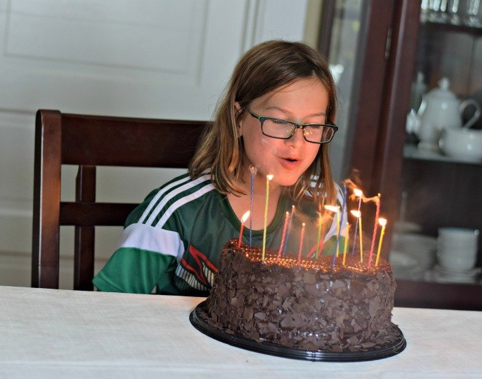 Blowing out candles on the huge cake