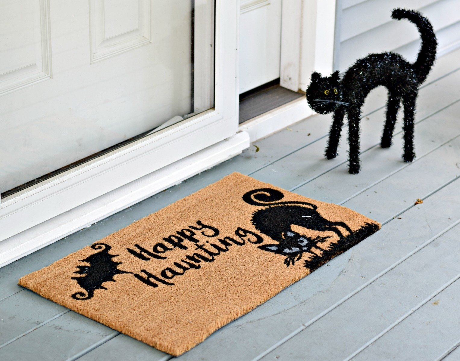 Halloween front porch statue and matching welcome mat