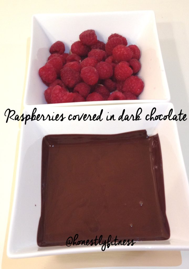 raspberries covered in dark chocolate by honestly fitness