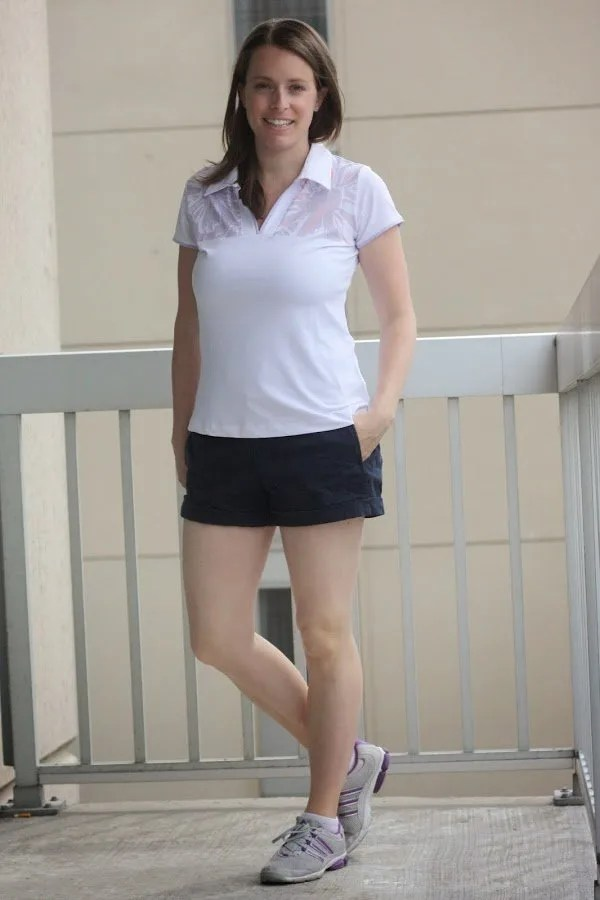 golf outfit white shirt and black shorts