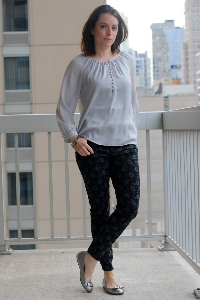 FashionablyEmployed.com | Gray blouse with black and gray floral jeans, silver flats | wear to work style, office attire, business casual outfit