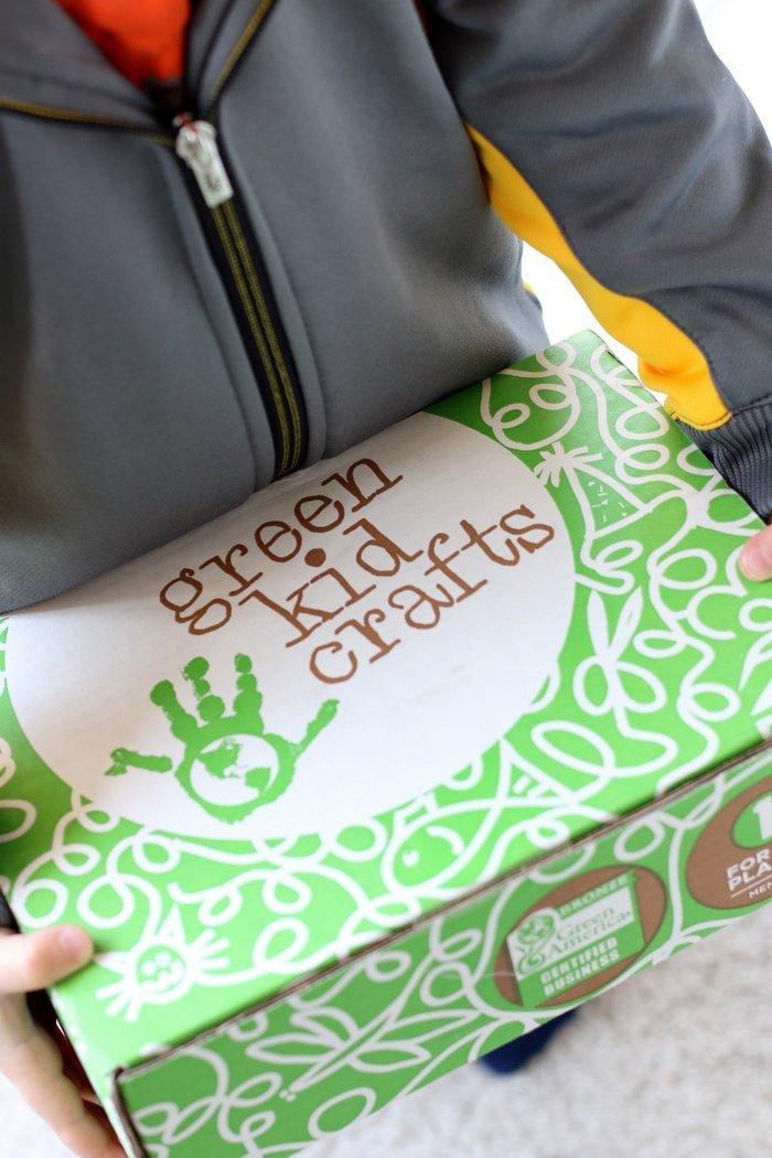 Holding Green Kid Crafts box