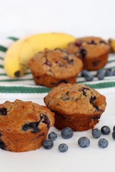 FashionablyEmployed.com   Blueberry Banana muffins with whole wheat, oats, and coconut oil.   Make ahead breakfast idea to streamline the morning.   Working mom blog for busy moms long on ambition and short on time, balancing career, family, style and a little time for ourselves.