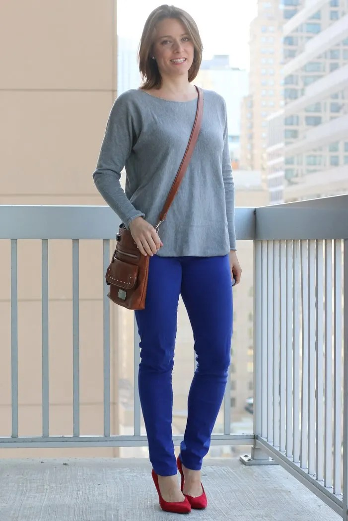 FashionablyEmployed.com | Simple, sustainable, chic style for the everyday professional woman | Cobalt jeans with gray sweater and pop of red from heels, unexpected color combination for Casual Friday at the office | perfect for work, office style for women