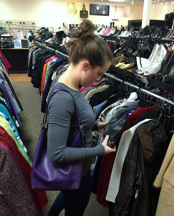 examining-boots-at-clothes-mentor