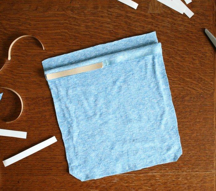 permanent-hem-tape-cut-on-folded-over-flap-of-drawstring-bag