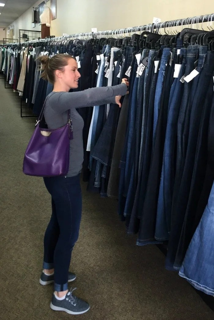 sorting-through-jeans-at-clothes-mentor