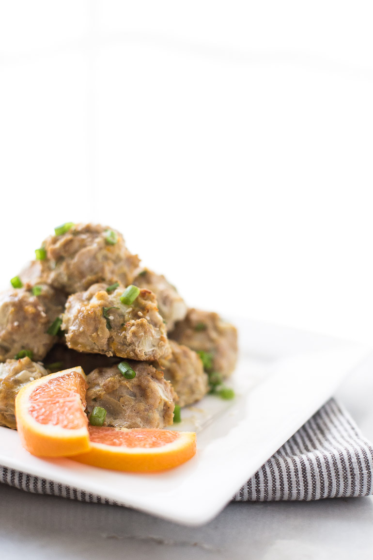 Healthy and Simple Baked Turkey Meatballs with Orange Ginger Glaze — Paleo, Gluten Free, Refined Sugar Free | These turkey meatballs take 10 minutes to prep and are loaded with Asian-inspired flavors. Perfect for a quick, healthy dinner when eaten over a bed of cauliflower rice or zucchini noodles, party appetizer, or even Game Day snack! | Honestly Nourished www.honestlynourished.com