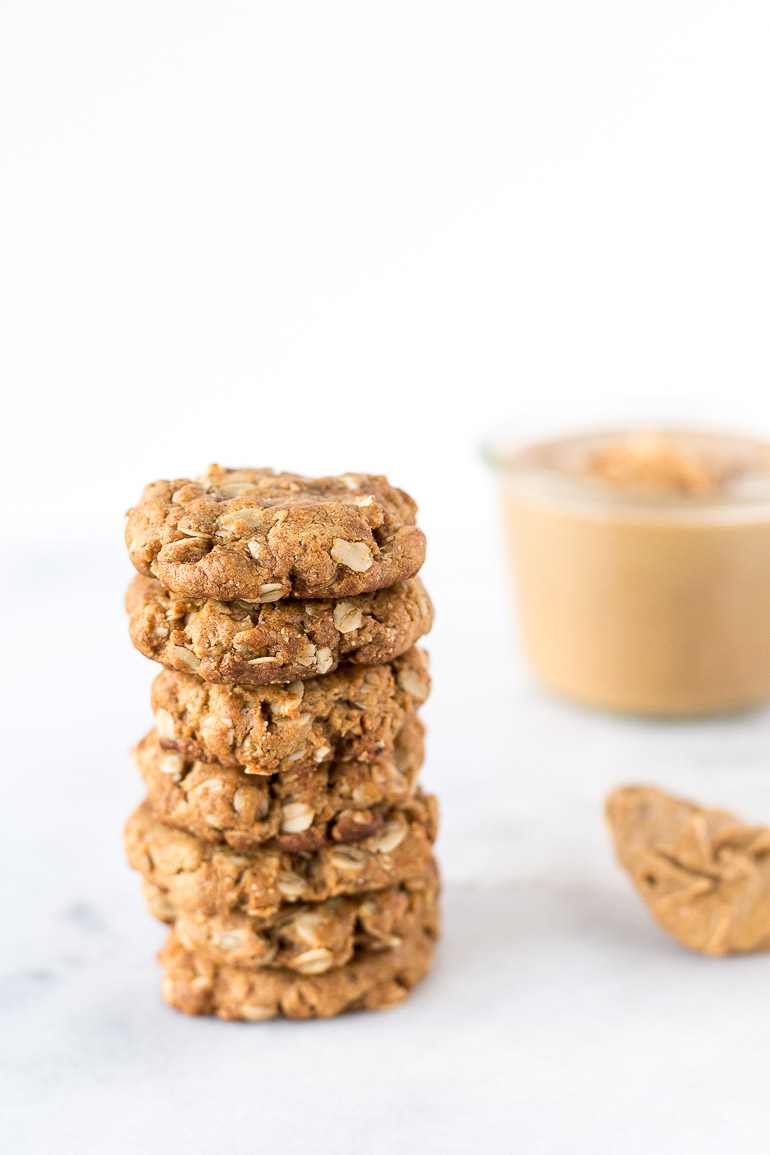 Healthier Flourless Peanut Butter Cookies | An updated takeon the classic peanut butter cookie made with only seven ingredients and no refined sugar, gluten, or butter! These cookies are light and chewy with the perfect amount of peanut butter flavor. Easily make them vegan with a simple substitution. | via Honestly Nourished