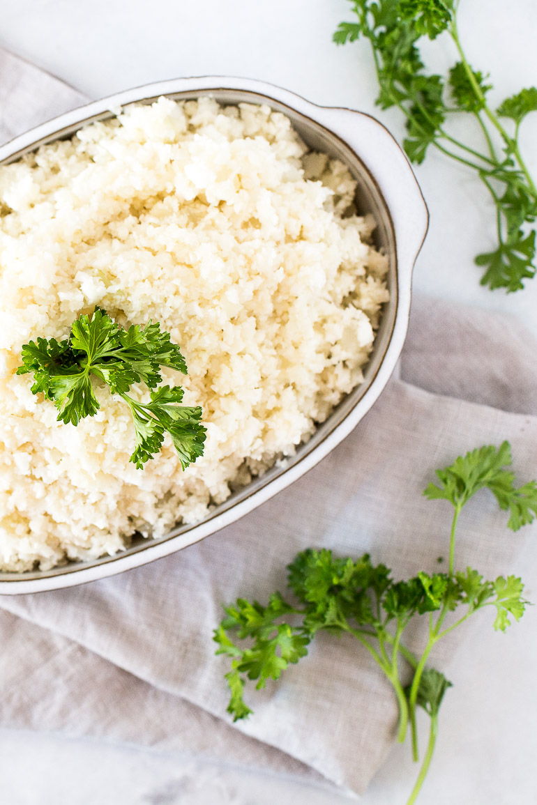 Learn how to make the best cauliflower rice! Whether you're looking to lighten up your meals or add more vegetables to your diet, low-carb and paleo-friendly cauliflower rice is a healthy alternative. This recipe makes a perfectly textured rice with no mushiness! | via Honestly Nourished