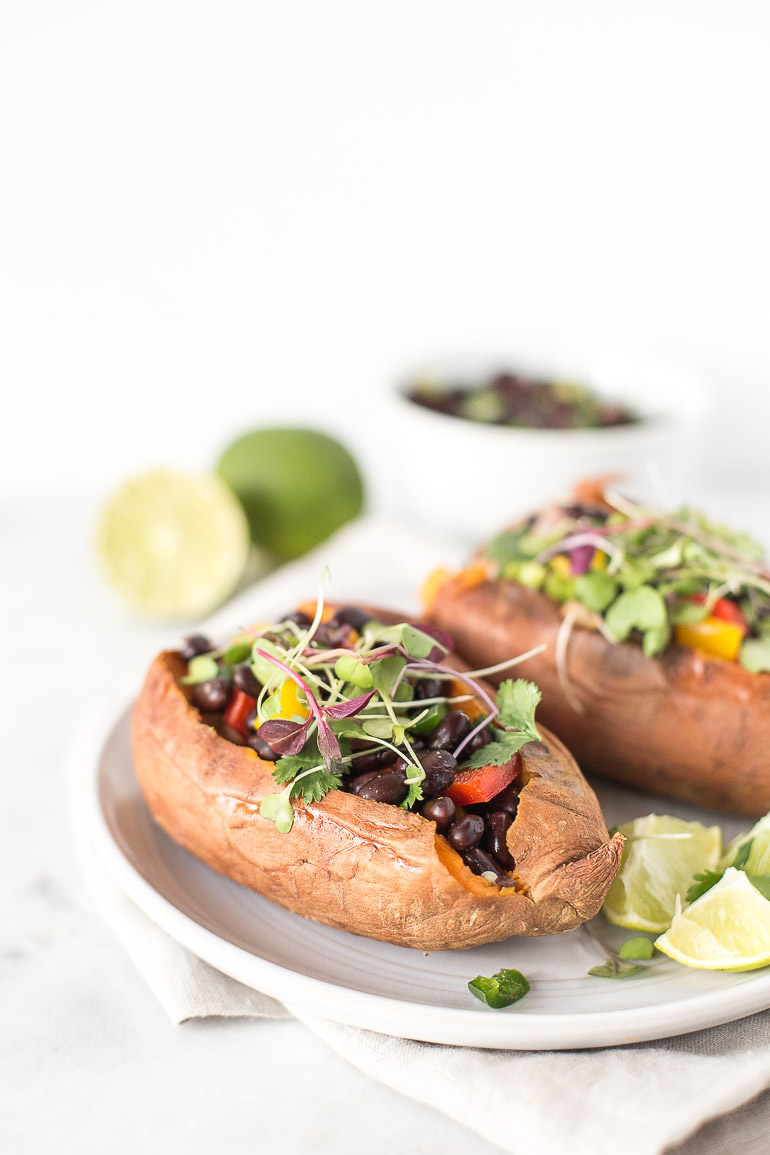 A nutrient-rich and hearty vegetarian meal that takes less than 5-10 minutes to prepare. These sweet potatoes stuffed with cilantro lime black beans will be your new go-to easy dinner. | via Honestly Nourished