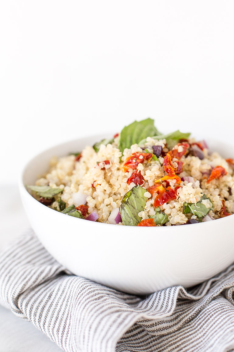 A simple, healthy, super versatile sun dried tomato and basil quinoa salad that's packed with plant-based protein and perfect for effortless weekday lunches and dinners. GF + DF + vegan + vegetarian | Honestly Nourished