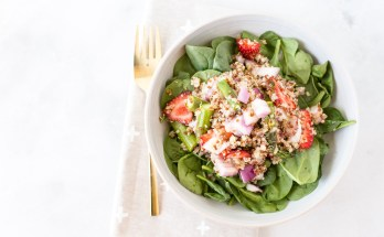 A nourishing and light summertime strawberry quinoa salad with asparagus and a honey lemon vinaigrette is the perfect side dish for picnics and barbecues. | vegan + gluten free + dairy free | via Honestly Nourished