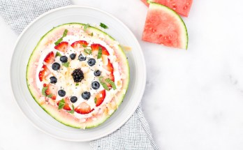 A refreshing summertime snack, this vegan watermelon fruit pizza with toasted coconut flakes, coconut yogurt, fresh berries, chia seeds, and crunchy granola is perfect for picnics and barbecues! | vegan + paleo + sugar free + raw option | via Honestly Nourished