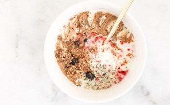 Finding a yogurt that's actually healthy can be overwhelming! Here's 5 nutritionist-approved tips to help clear the confusion, PLUS an energizing and nourishing superfood vegan vanilla coconut yogurt bowl recipe—a perfect paleo-friendly, dairy-free snack or breakfast!