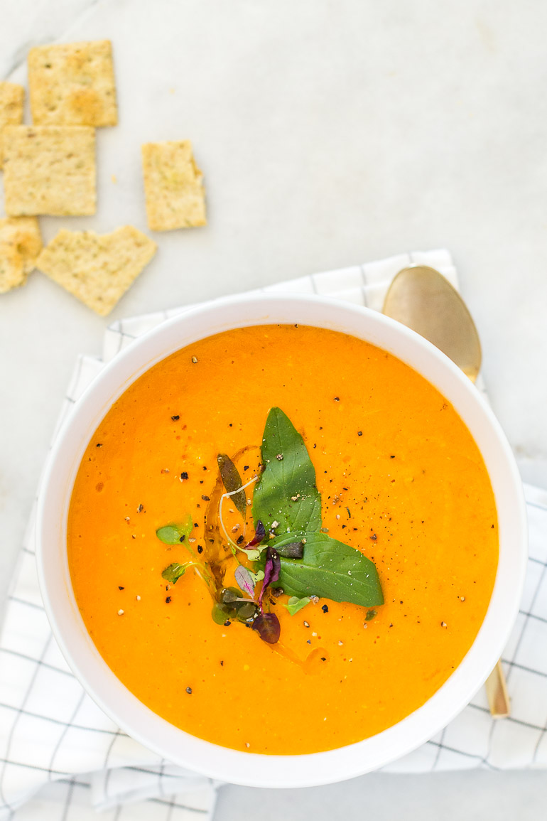 A slightly elevated take on a childhood classic, this three-ingredient golden jubilee heirloom tomato soup lets seasonal tomatoes shine. It's creamy, comforting, and crazy flavorful. Everyone will LOVE this tomato soup! | freezer friendly + paleo + vegan + 30 minutes or less | via Honestly Nourished