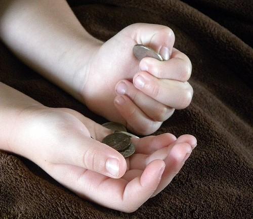 money coins in kids hands