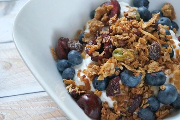 Homemade fresh cherry granola with fruit and yogurt