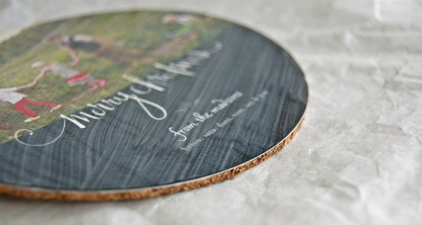 Making DIY Coasters with corkboard, apply modpodge over the top of the photo