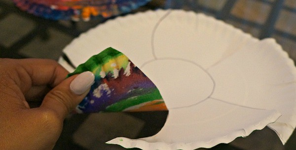 Cutting paper plates for an Easter basket craft