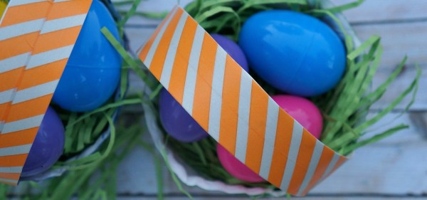 Top handle of paper plate Easter basket craft, decorated with washi tape
