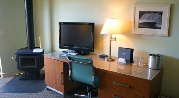The Acqua Hotel, Inside The Waterfront Junior Suite, Cast Iron fireplace, TV and desk