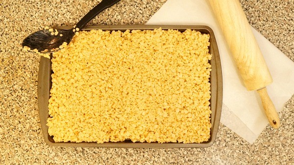 Roll out rice krispies onto a cookie sheet