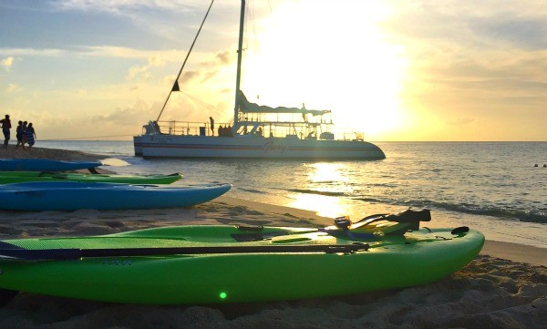 Kayaks at dusk, sunset behind Fury Catamaran, Cozumel snorkeling trip