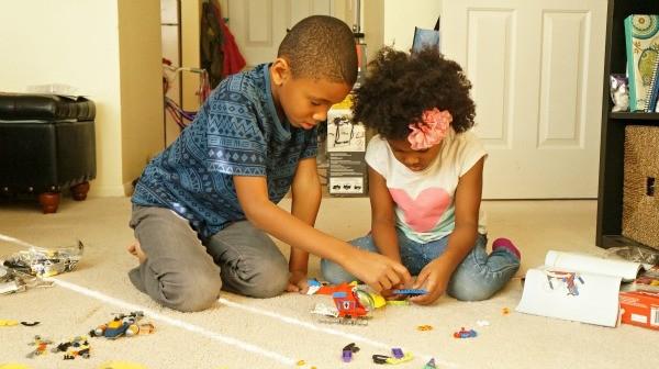 LEGO® Super Heroes Kids building LEGO sets