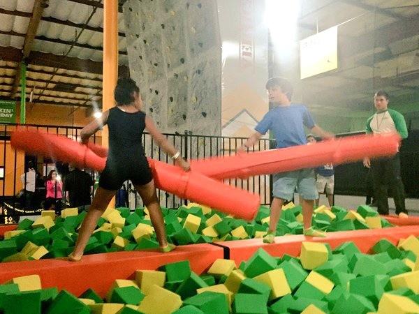 Rockin Jump San Diego, kids battle on the X beam